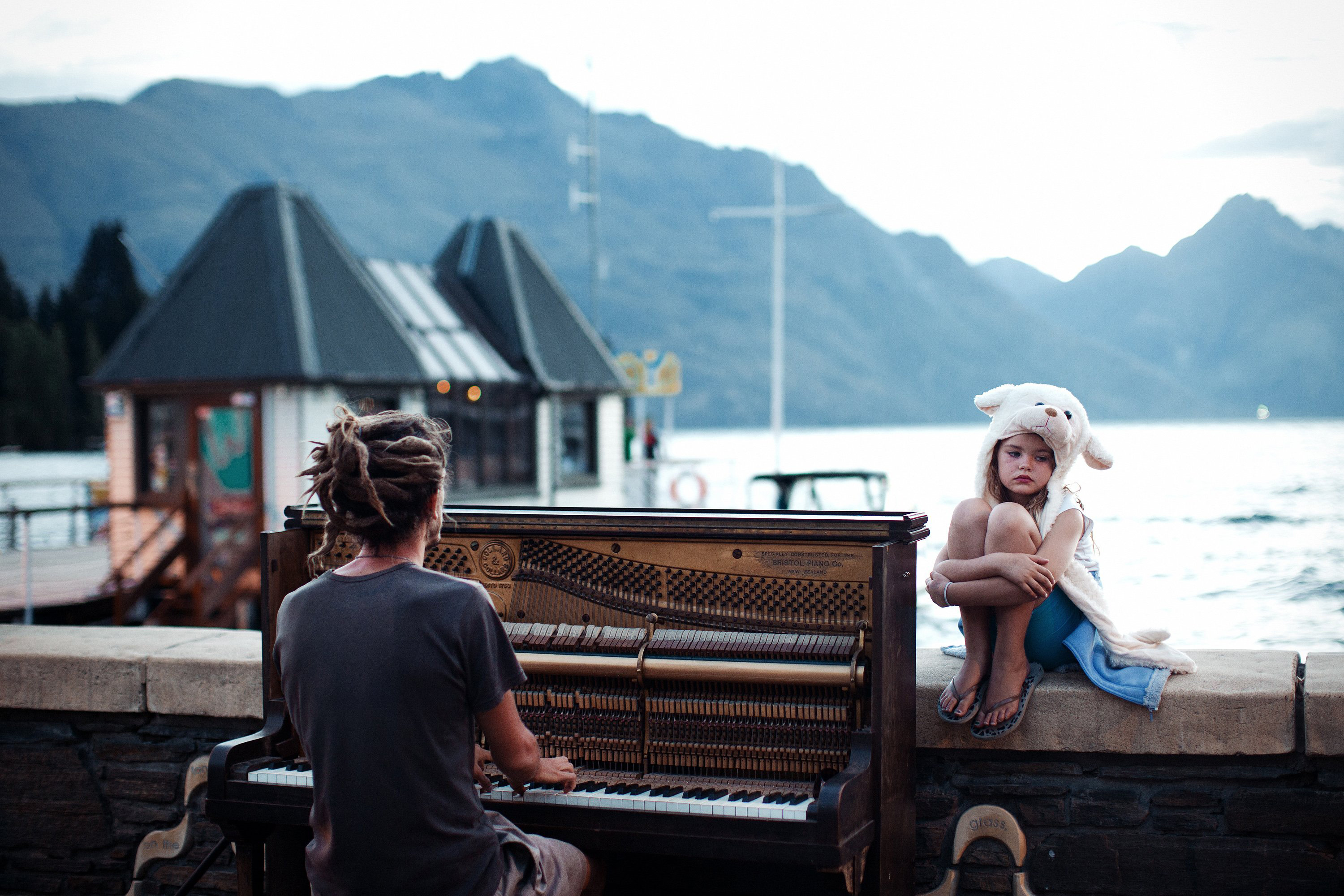 Piano play at sunset - Streets of Queenstown, New Zealand at the end of one more day filled with adrenaline. Calming and doleful scene with piano sound in the background. (Nikola Smernic/National Geographic Traveler Photo Contest)
