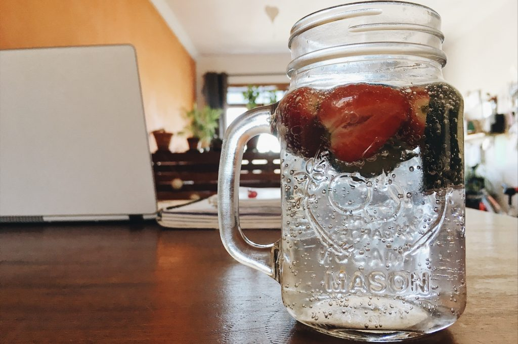 water with strawberries in
